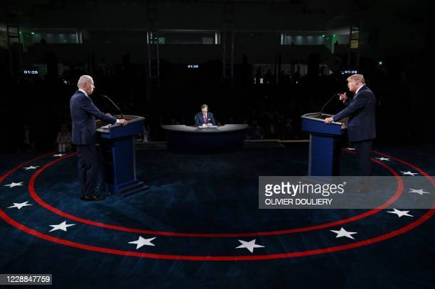 President Donald Trump and Democratic presidential candidate Joe Biden participate in the first presidential debate at the Health Education Campus of...