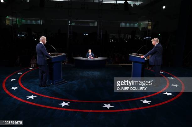 President Donald Trump and Democratic presidential candidate Joe Biden take part in the first presidential debate at Case Western Reserve University...