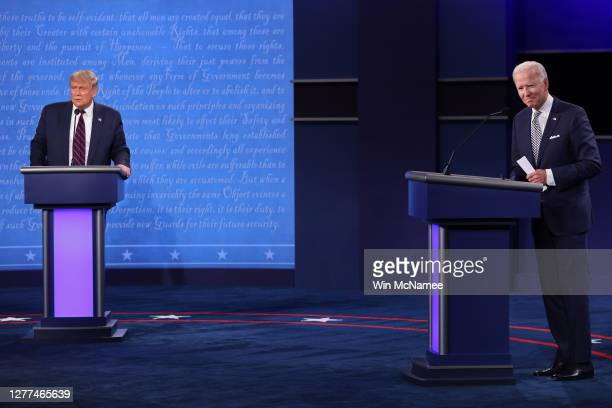 President Donald Trump and Democratic presidential nominee Joe Biden look out to the audience at end of the first presidential debate at the Health...