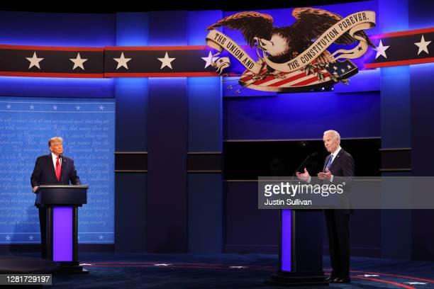 President Donald Trump and Democratic presidential nominee Joe Biden participate in the final presidential debate at Belmont University on October...