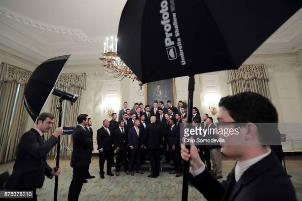 US President Donald Trump and Education Secretary Betsy Devos visit with members of the National Collegiate Athletic Association's champion...