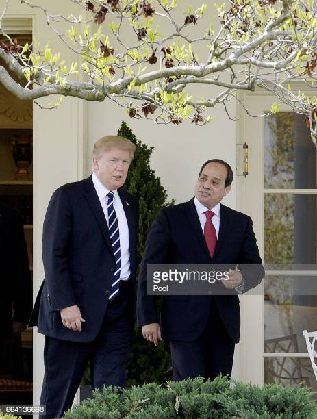 US President Donald Trump and Egypt President Abdel Fattah Al Sisi leave the Oval Office of White House to walk to the Residence on April 3 2017 in...