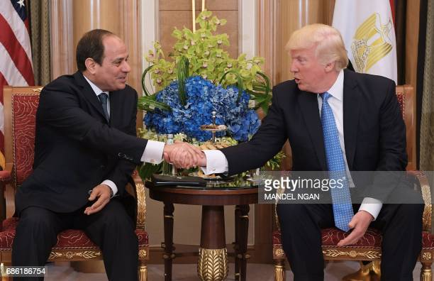 US President Donald Trump and Egypt's President Abdel Fattah alSisi take part in a bilateral meeting at a hotel in the Saudi capital Riyadh on May 21...