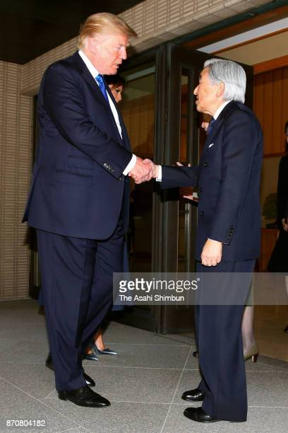 US President Donald Trump and Emperor Akihito shake hands after their meeting at the Imperial Palace on November 6 2017 in Tokyo Japan Trump is on...