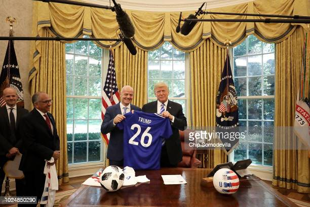 S President Donald Trump and FIFA President Gianni Infantino pose for photographs with a soccer uniform in the Oval Office at the White House August...