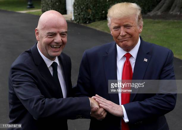 S President Donald Trump and FIFA President Gianni Infantino speak to members of the press following a meeting at the White House on September 09...