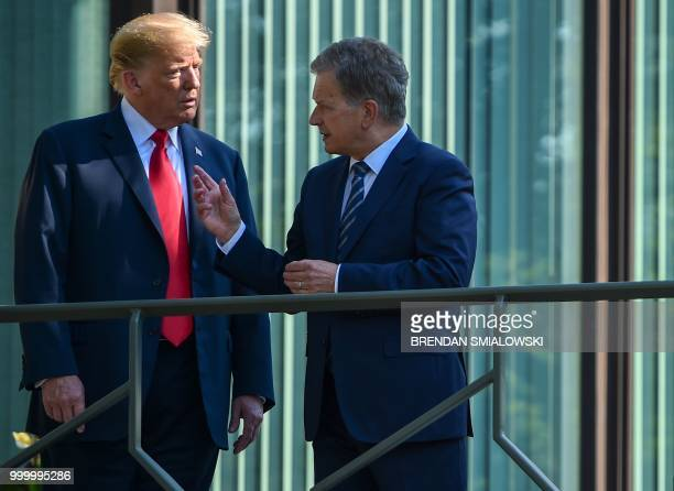 US President Donald Trump and Finnish President Sauli Niinisto talk on the balcony of the Mantyniemi Presidential Residence in Helsinki on July 16...