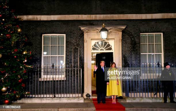 President Donald Trump and first lady Melania arrive at 10 Downing Street in central London on December 3 to attend a reception hosted by Britain's...