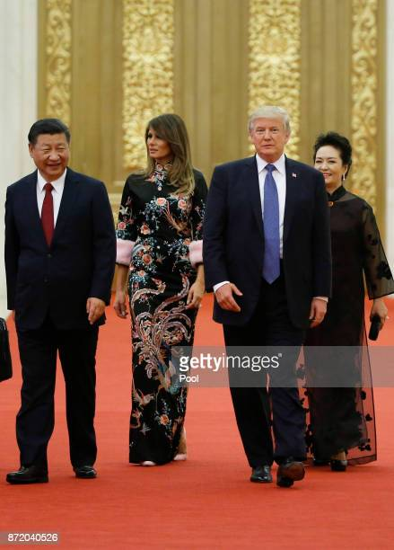 S President Donald Trump and first lady Melania arrive for the state dinner with China's President Xi Jinping and China's first lady Peng Liyuan at...