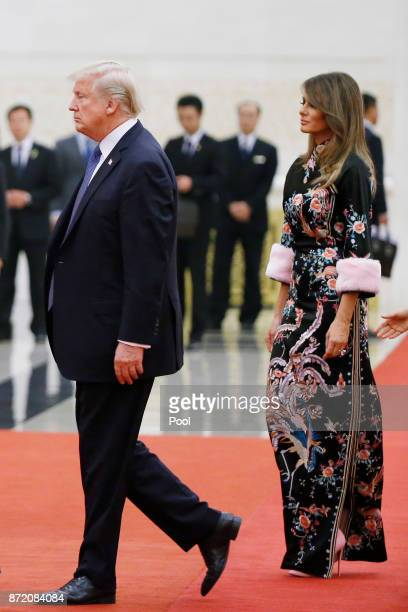 S President Donald Trump and first lady Melania arrive for the state dinner at the Great Hall of the People on November 9 2017 in Beijing China Trump...