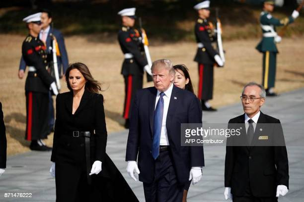 US President Donald Trump and First Lady Melania arrive to lay a wreath at the National Cemetery in Seoul on November 8 2017 Trump offered North...