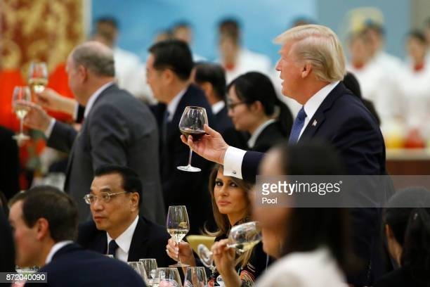 S President Donald Trump and First Lady Melania attend at a state dinner at the Great Hall of the People on November 9 2017 in Beijing China Trump is...
