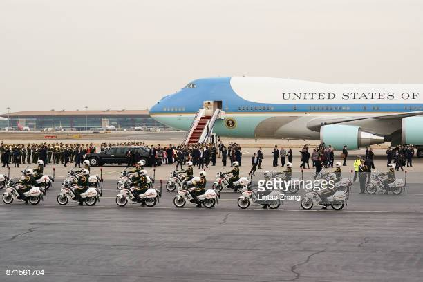S President Donald Trump and first lady Melania depart from the tarmac after their arrival at Beijing Capital Airport on November 8 2017 in Beijing...