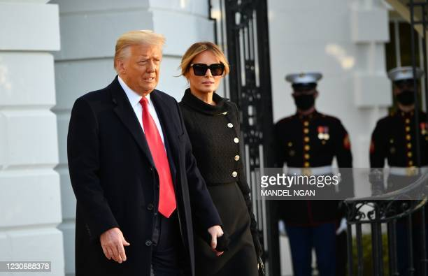 President Donald Trump and First Lady Melania make their way to board Marine One before departing from the South Lawn of the White House in...