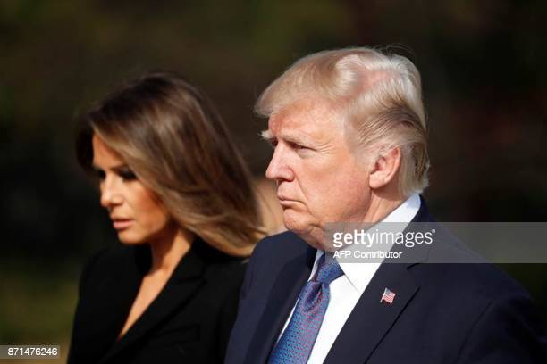 US President Donald Trump and First Lady Melania pay a silent tribute at the National Cemetery in Seoul on November 8 2017 Trump offered North Korean...
