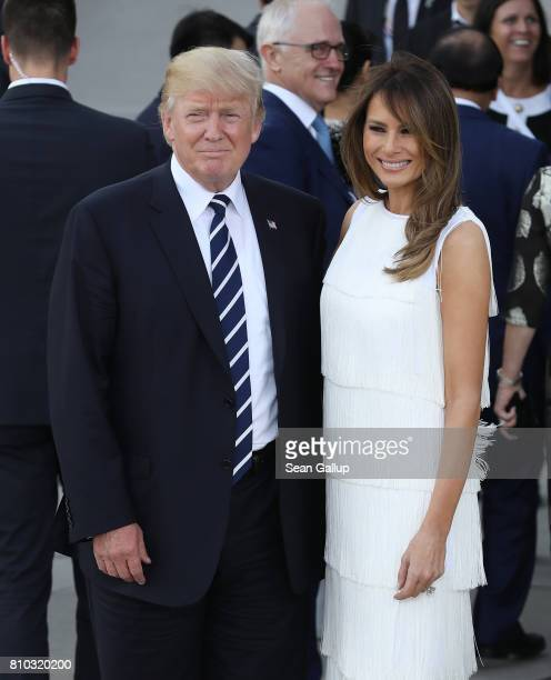 S President Donald Trump and First Lady Melania pose briefly upon their arrival at the Elbphilharmonie philharmonic concert hall on the first day of...