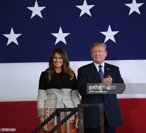 US President Donald Trump and First Lady Melania smile upon arriving at US Yokota Air Base in Tokyo on November 5 2017 Trump touched down in Japan...
