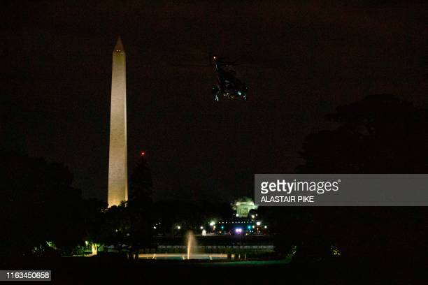US President Donald Trump and First Lady Melania Trump aboard Marine One depart the White House in Washington DC on August 23 for the G7 Summit in...