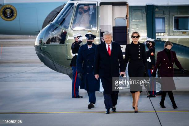 President Donald Trump and First Lady Melania Trump acknowledge waiting supporters at Joint Base Andrews before boarding Air Force One for his last...