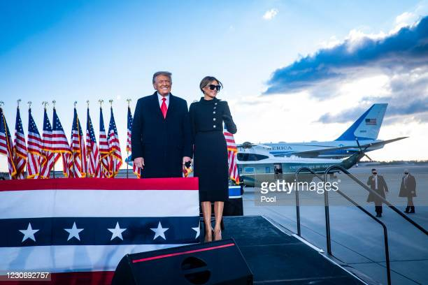 President Donald Trump and First Lady Melania Trump acknowledge supporters at Joint Base Andrews before boarding Air Force One for his last time as...