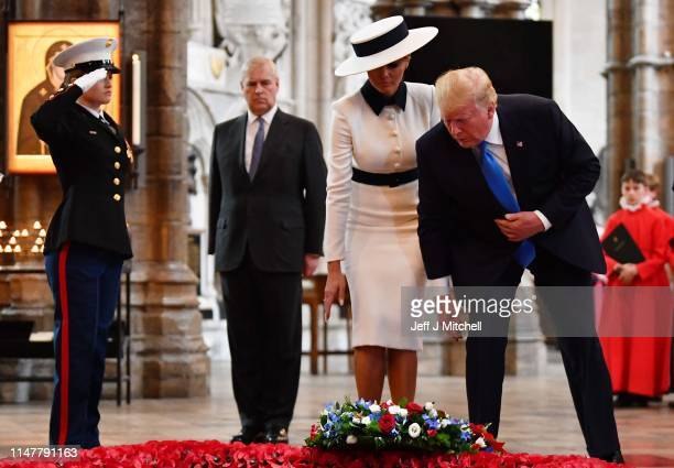 President Donald Trump and First Lady Melania Trump alongside Prince Andrew Duke of York pay their respects at the Tomb of the Unknown Warrior in...