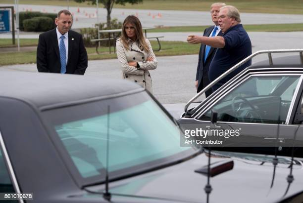 US President Donald Trump and First Lady Melania Trump alongside US Secret Service Director Randolph Alles look at a 1983 Cadillac limousine used by...