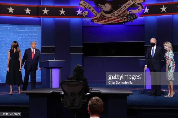 President Donald Trump and first lady Melania Trump and Democratic presidential nominee Joe Biden and Jill Biden on stage after the final...