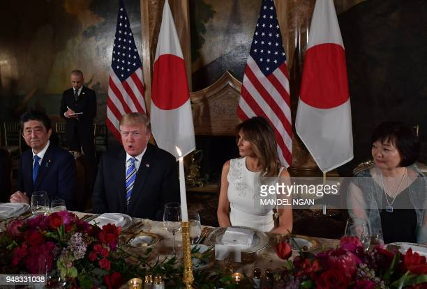 US President Donald Trump and First Lady Melania Trump and Japan's Prime Minister Shinzo Abe and his wife Akie Abe take part in a dinner at Trump's...