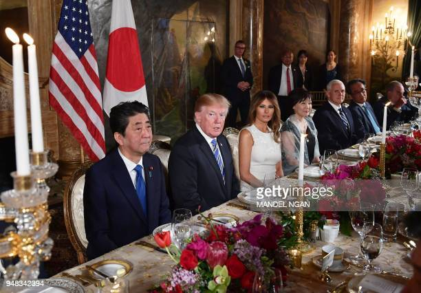 President Donald Trump and First Lady Melania Trump and Japan's Prime Minister Shinzo Abe and his wife Akie Abe take part in a dinner at Trump's...