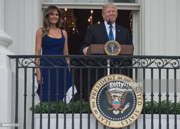 President Donald Trump and First Lady Melania Trump appear on the Truman Balcony during the military families picnic at the White House in...