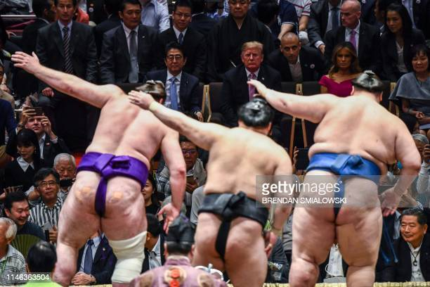 President Donald Trump and First Lady Melania Trump are accompanied by Japan's Prime Minister Shinzo Abe and his wife Akie Abe as they watch a sumo...