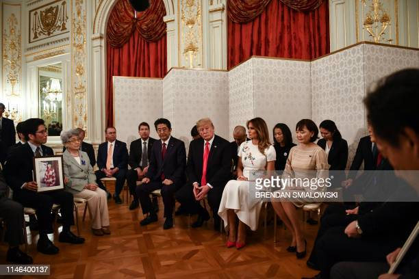 President Donald Trump and First Lady Melania Trump are accompanied by Japan's Prime Minister Shinzo Abe and his wife Akie Abe during a meeting with...