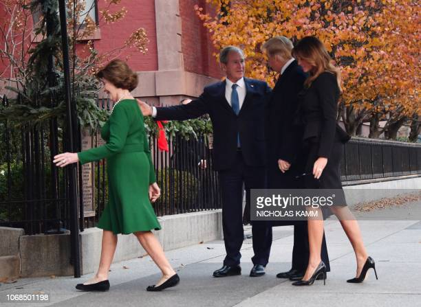 President Donald Trump and first lady Melania Trump are greeted by former US President George W Bush and his wife former first lady Laura Bush at...