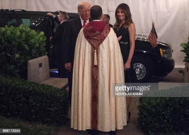 US President Donald Trump and First Lady Melania Trump are greeted by Rev James Harlan as they arrive at the Church of BethesdabytheSea for Midnight...