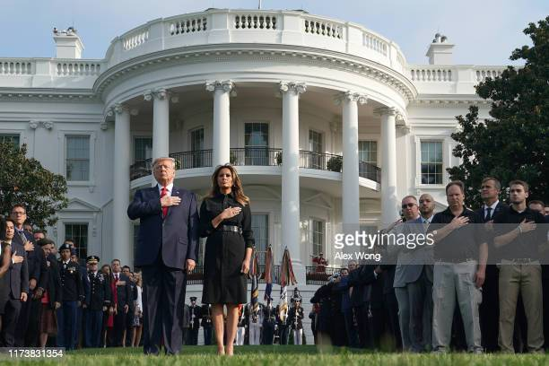 S President Donald Trump and first lady Melania Trump are joined by survivors victims' families and White House staff as they participate in a moment...