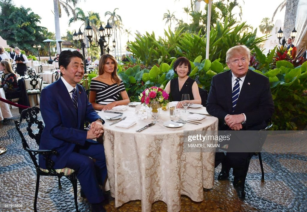 President Donald Trump and First Lady Melania Trump are seated for dinner with Japan's Prime Minister Shinzo Abe and wife Akie Abe at Trump's Mar-a-Lago resort in Palm Beach, Florida on April 17, 2018.