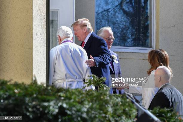 US President Donald Trump and First Lady Melania Trump are welcomed by interim rector Bruce McPherson as they arrive at St Johns Episcopal church in...