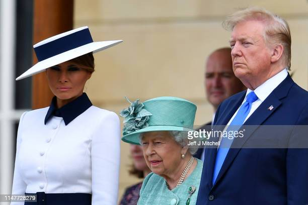 President Donald Trump and First Lady Melania Trump are welcomed by Queen Elizabeth II at Buckingham Palace on June 3 2019 in London England...