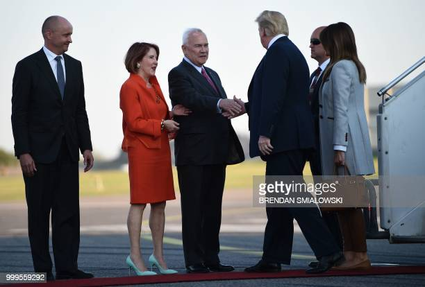 US President Donald Trump and First Lady Melania Trump are welcomed by US ambassador to Finland Robert Frank Pence and his wife Susan Sarbacher upon...