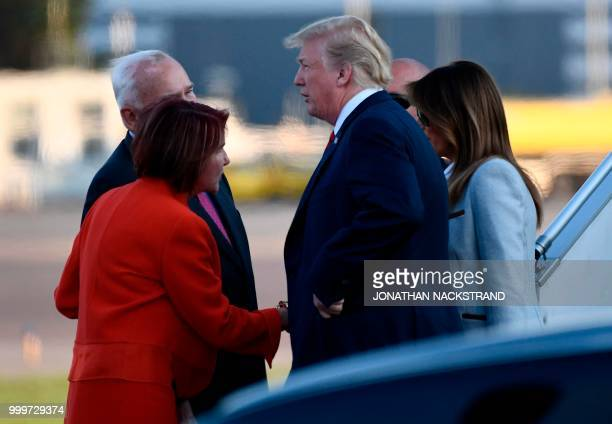 US President Donald Trump and First Lady Melania Trump are welcomed by US ambassador to Finland Robert Frank Pence and his wife Susan SarbacherPence...