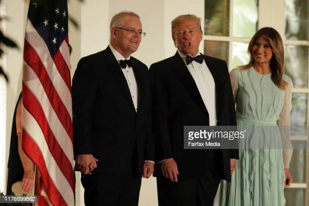 US President Donald Trump and First Lady Melania Trump arrive at a state dinner with the Australian Prime Minister Scott Morrison and his wife Jenny...