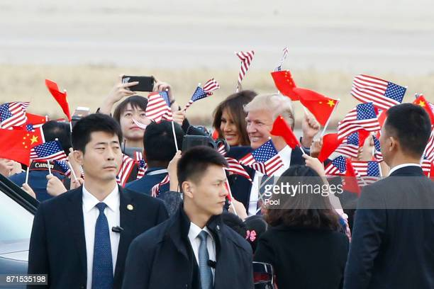 S President Donald Trump and first lady Melania Trump arrive at Beijing airport on November 8 2017 in Beijing China Trump is in China as a part of...