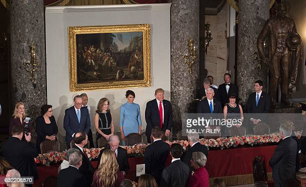 US President Donald Trump and First Lady Melania Trump arrive at Statuary Hall along with Vice President Mike Pence his wife Karen House Speaker Paul...