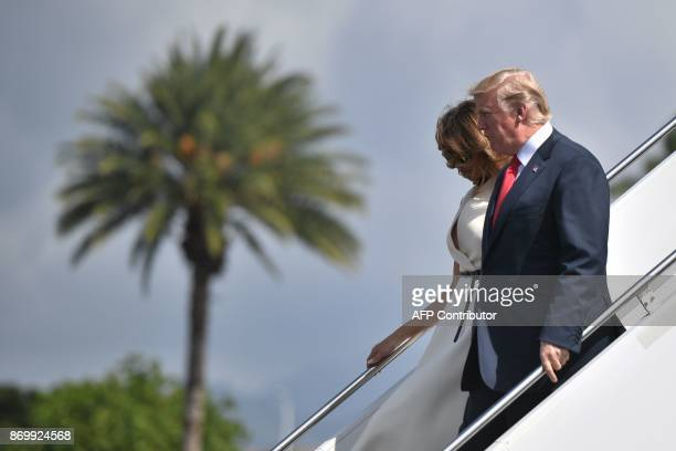 US President Donald Trump and First Lady Melania Trump arrive at Joint Base Pearl HarborHickam in Hawaii on November 3 2017 The Trumps are in Hawaii...