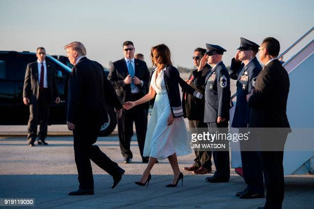 US President Donald Trump and First Lady Melania Trump arrive at Palm Beach International Airport in West Palm Beach Florida on February 16 2018 /...