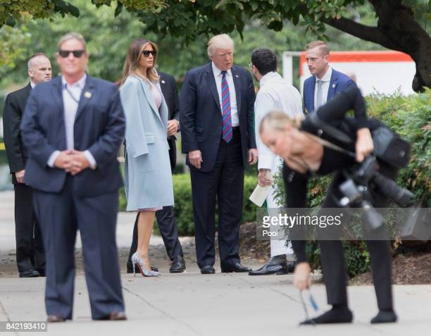 US President Donald Trump and First Lady Melania Trump arrive at St John's Church on September 3 2017 in Washington DC Earlier this week Trump signed...