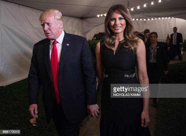 US President Donald Trump and First Lady Melania Trump arrive at the Church of BethesdabytheSea for Midnight Mass in Palm Beach Florida on December...