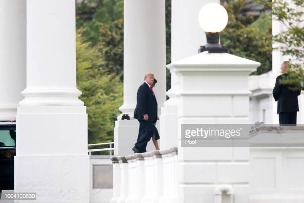 S President Donald Trump and First Lady Melania Trump arrive at the North Portico of the White House on July 22 2018 in Washington DC Trump and the...