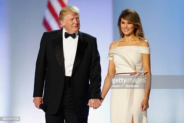 President Donald Trump and first lady Melania Trump arrive at the Freedom Inaugural Ball at the Washington Convention Center January 20, 2017 in...