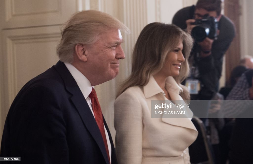 US President Donald Trump and First Lady Melania Trump arrive at the Womens Empowerment Panel in the East Room of the White House in Washington, DC, on March 29, 2017. /